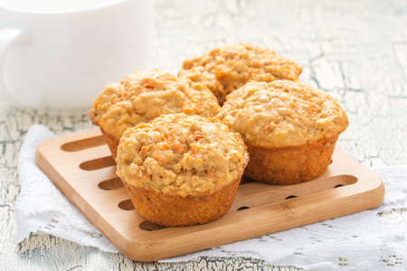 Delicious and homemade carrot oatmeal muffins photographed closeup.