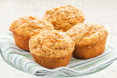 Delicious homemade carrot oatmeal muffins photographed closeup.