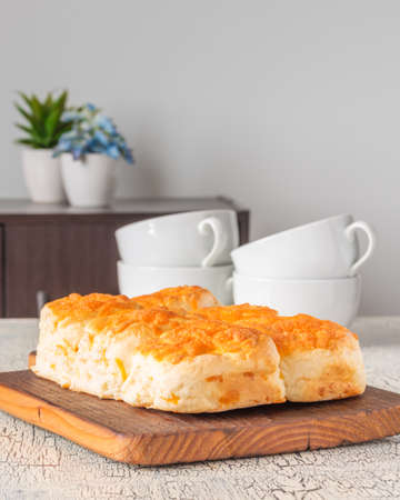 Fresh homemade cheddar cheese tea biscuits.  Ample room for text. Imagens