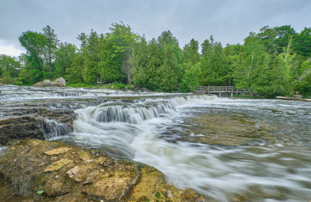 The sauble river cascades over rocks creating this pretty waterfall in Bruce County Ontario. Stock Photo