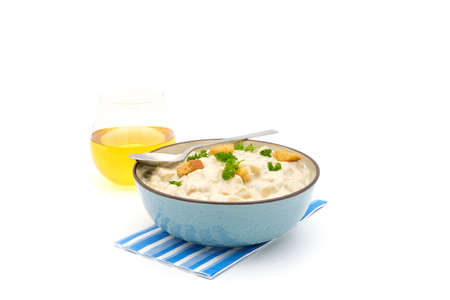 Bowl of homemade clam chowder photographed on a white background. Stock Photo