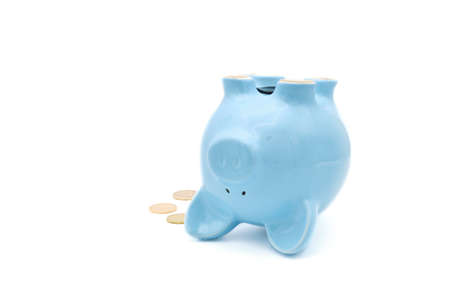 Ceramic piggy bank laying on its back useful for poor or failing economy concept.