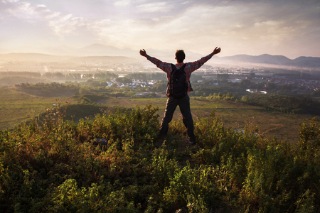 On the top of the mountain with open arms to greet the rays