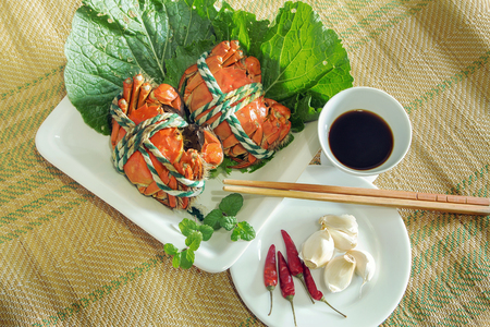 Top view of crab dishes on a bamboo mat