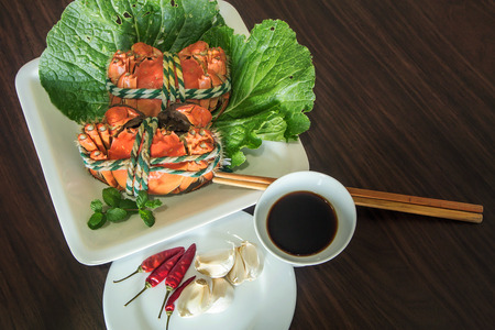 Top view of crab dishes on wooden table Imagens