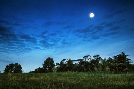 The moon shines over the hillside