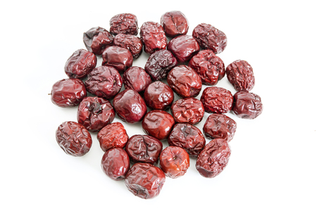 A pile of red dates on white background