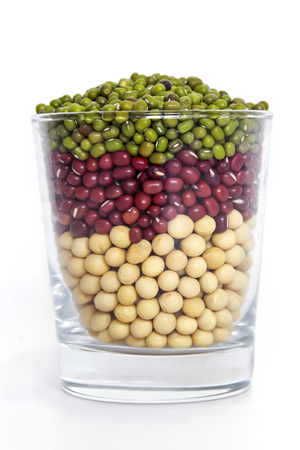 Various beans in a glass cup Imagens