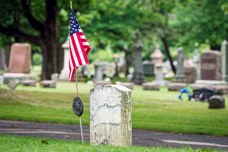 american hero: A flag on the Union grave of a Civil War veteran at a Wisconsin cemetery. Stock Photo