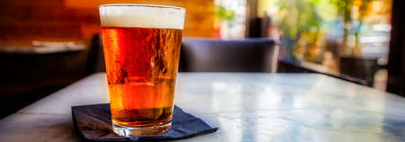 An ice cold beer, like the song says, it's five o'clock somewhere. Stock Photo