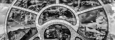 The sky reflecting off the front of a World War Two bomber's cockpit. Stock Photo