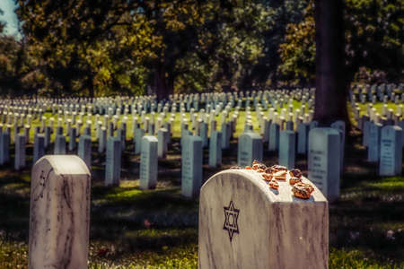 Some Jews believe putting stones on a grave keeps the soul in this world, which some find comforting. Others believe the stones keep demons from getting into the graves.  A stone does not die like flowers and can symbolize the permanence of memory and leg