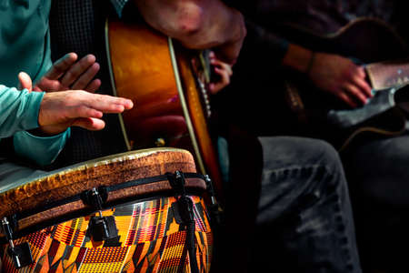 A small acoustic band performing tunes on a street in the District of Columbia. Stock Photo