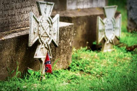 A miniature confederate flag on a Civil War veterans grave in Virginia.