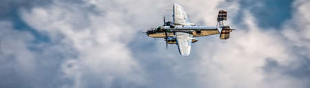 A World War Two bomber takes to the air on a cloudy day.