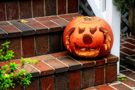 A traditional jackolantern out for Halloween on the streets of Alexandria, Virginia. Stock Photo