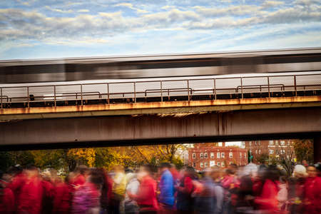 Runners leaving the starting line as a train departs behind in Washington DC.
