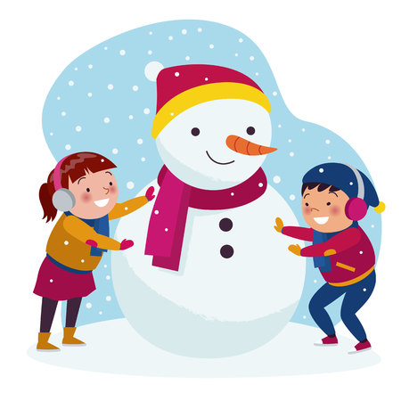 Boys and girls are playing building a snowman in winter