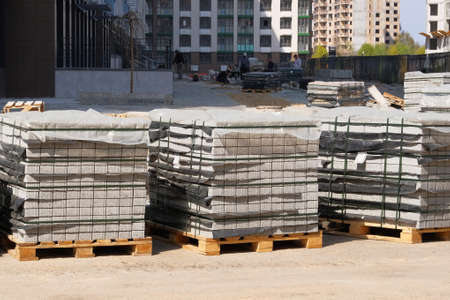 Construction Materials. Building materials for construction of residential complex. Pile of gray bricks at construction site. 版權商用圖片