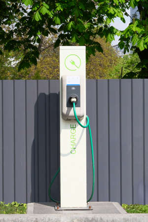 Electric charging station. Eco friendly transport concept. Sign on front of charging station. Vertical view. Reklamní fotografie
