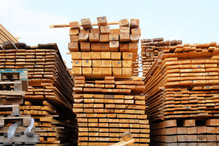 Wooden planks for construction are sold in the market. Stack of new wooden planks. Close up. Stock Photo