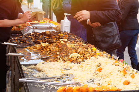 Mussels, shrimp and other seafood on street market, takeaway. Fast or street food concept. Festival of fish and seafood Cuisine. Stock fotó