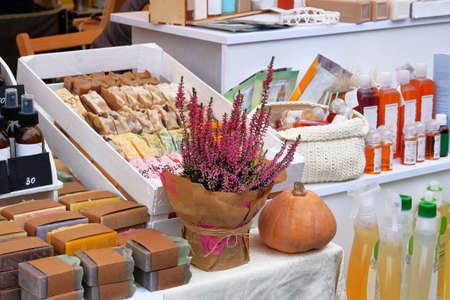 Cosmetics with organic natural ingredients sold at the fair. Handmade natural cosmetics. Variety of herbal cosmetic products.