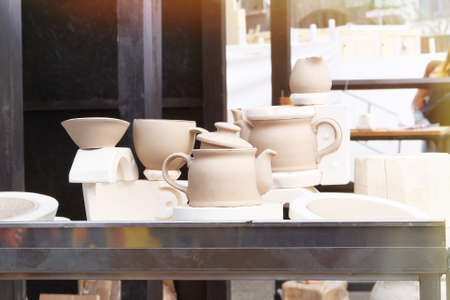 Handmade clay pots after potters wheel. Pottery, and craftsmanship concept. Workshop for handicraft. Stock fotó