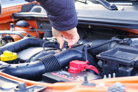 Car diagnostic and repair concept. Hands of driver checks car, open hood. Auto and vehicle servicing, close up. Zdjęcie Seryjne