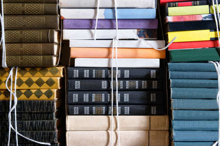 Book stack of step to success concept, closeup. Vintage books with empty labels with free copy space. Reklamní fotografie