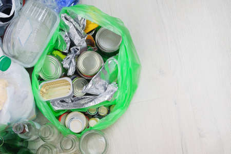 Metal and tin packaging prepared for recycling. Metal debris to be recycled. Recyclable materials.