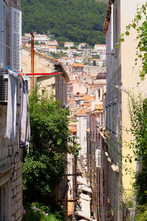 Passage between walls to the old town, the historical part of the city. Between walls of houses, rooftop view. Summer in Croatia, Dubrovnik