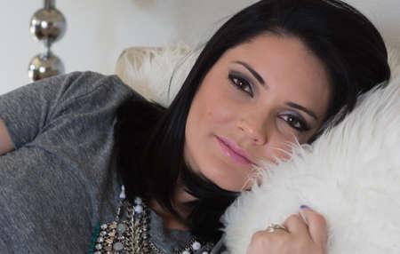 dark haired: Beautiful dark haired model on white pillow