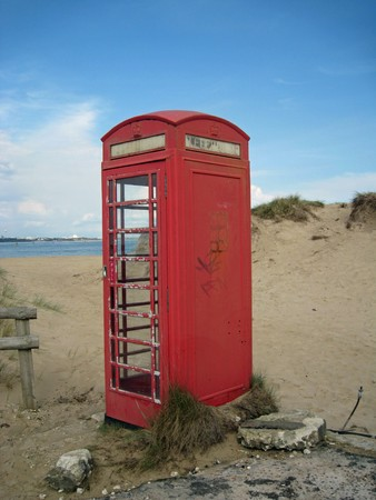 typically english: Typically English Public Telephone, near a Beach in Great Britain.