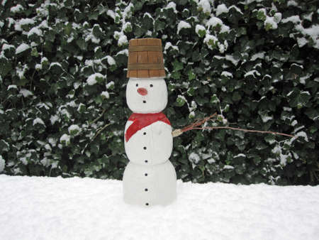 Puppet of Snow Man standing in the snow Stock Photo - 8476653