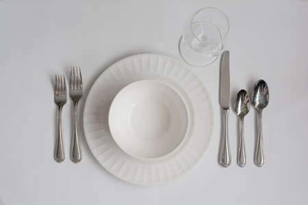 formal place setting: Formal Dinner Place Setting Utensils with White Wine Glass