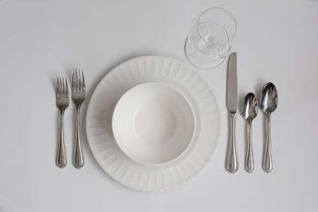 formal dinner: Formal Dinner Place Setting Utensils with White Wine Glass
