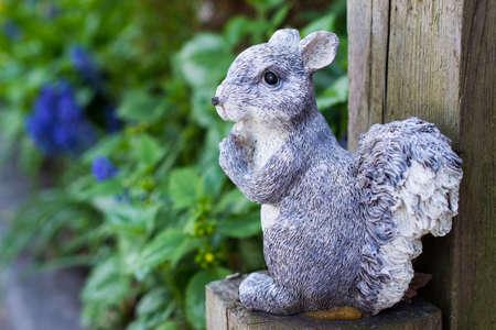wooden post: Squirrel garden decoration on wooden post Stock Photo