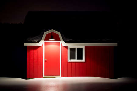 white trim: Small red barn with white trim in icy snow