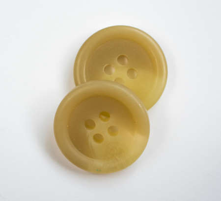 cream colored: Two Cream Colored Plastic Buttons Isolated on White Stock Photo