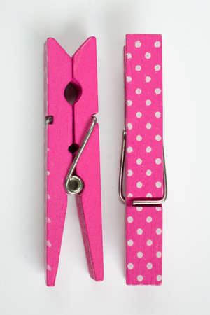 flipped: Two Pink Clothes Pins with Fun Patterns One Flipped Top View Stock Photo