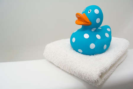 squeaky clean: Cute Rubber Duck on a White Towel in a Bathroom