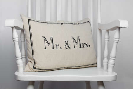 Mr and Mrs romantic pillow on white rocking chair