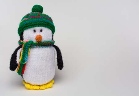 Penguin stuffed toy on white background copy space