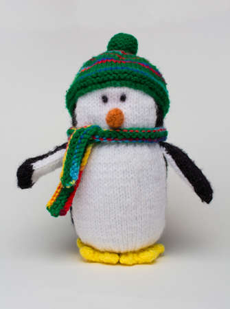 Penguin stuffed toy on white background vertical Stock Photo