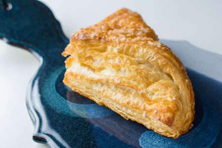 Apple turnover pastry on platter close up