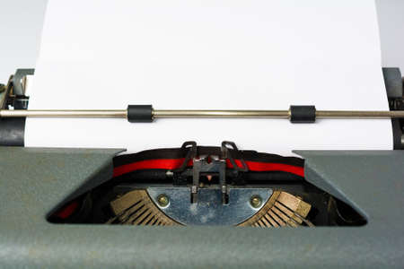 Antique Typewriter on White Background with Paper Close Up