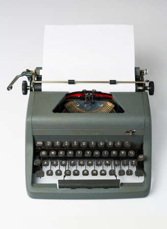 Antique Typewriter on White Background with Paper in Perspective Stock Photo