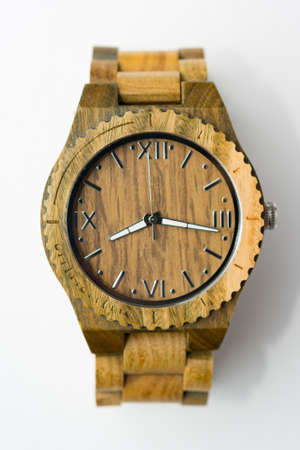 Interesting Wooden Watch on White Background Top View Stock Photo