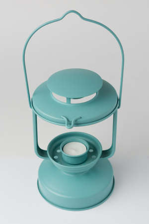 Teal Metal Candle Lantern on White Background Perspective View